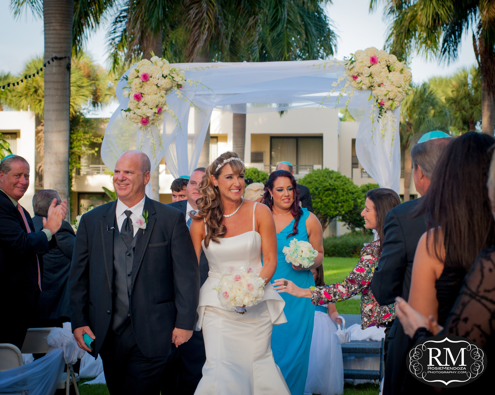 Happily ever after starts right now… Held at the Hyatt Regency Pier Sixty Six in Fort Lauderdale, bride and groom wed in a beautiful courtyard ceremony in front of close family and friends.