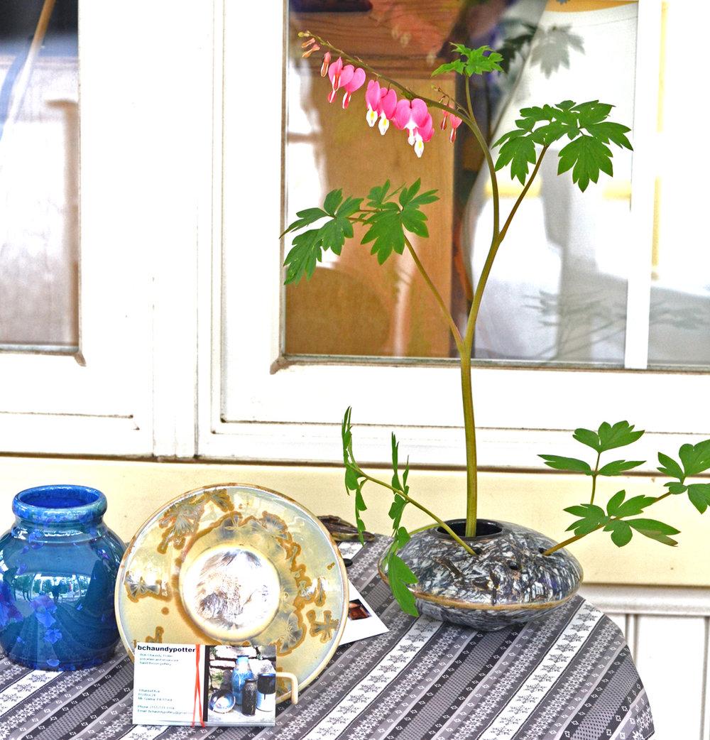 Bob's (crystaline glazed pots)and my work (flower pillow)