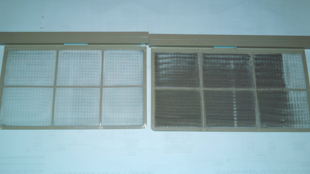 Two filters from my daughter's through-wall air conditioner - one before and one after cleaning
