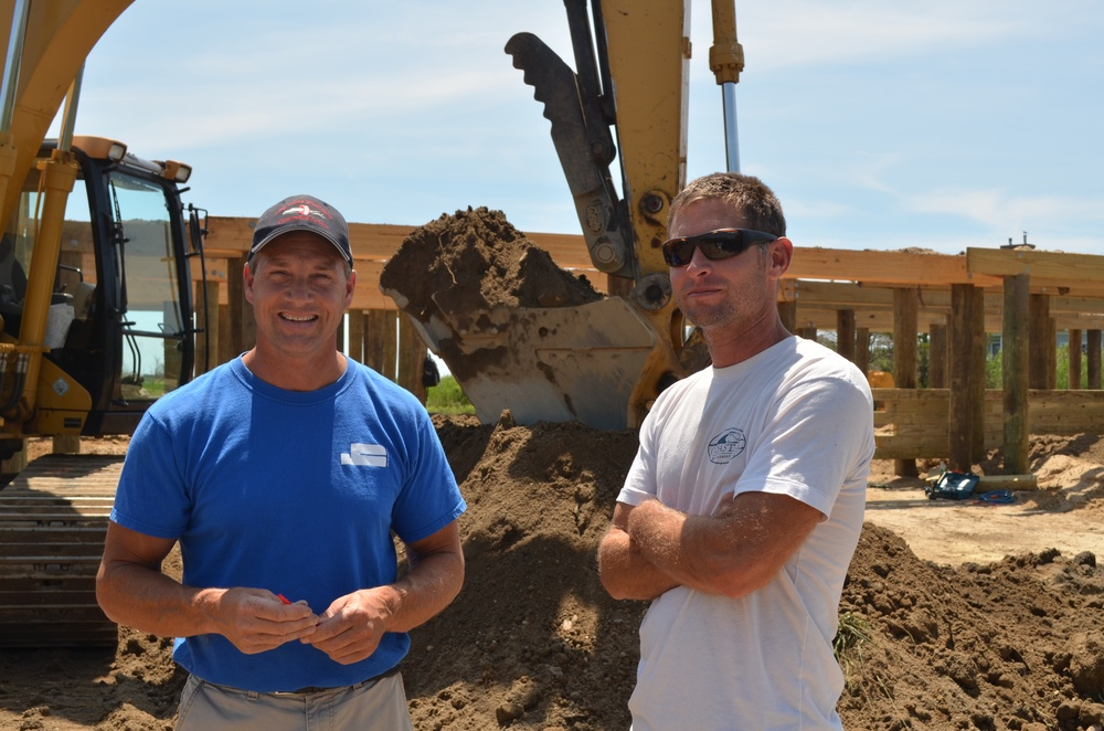 Tom Freund (left) and Chris Mensch (right) at the Sunset Green Home project site