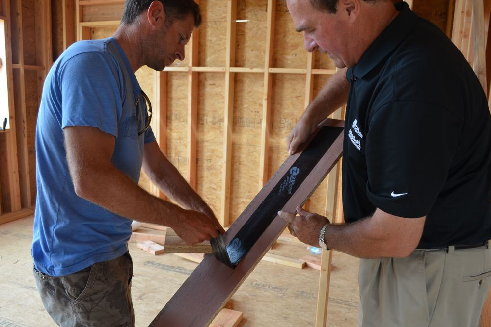 Mike Machernis (Right) Demonstrating ZIP System Tape Strength