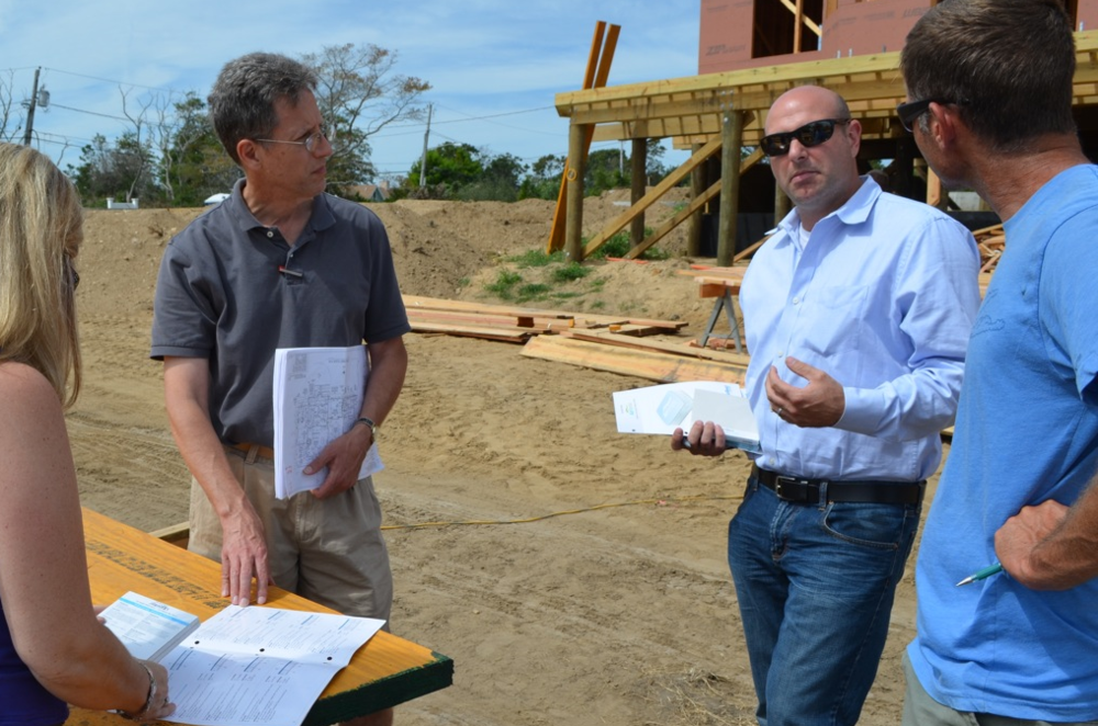 Kathryn Cannon, LEED AP Homes (left), Bill Heine, Architect (second from left) and Chris Mensch, partner at Coastal Management (right) learn about CertainTeed's VOC scavenging gypsum and other innovative gypsum products from Chris Reardon, Strategic Account Manager at CertainTeed