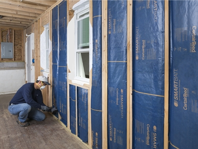 CertainTeed's SMARTBATT with smart vapor retarder will be installed to R-21 in Sunset Green Home's exterior walls (photo courtesy of CertainTeed)