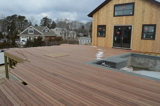 Decking extends from the main house to the pool house.