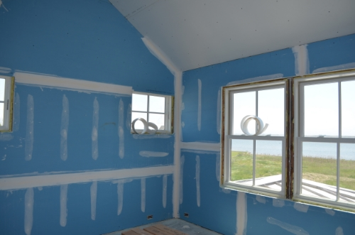 The same bedroom with AirRenew installed on the walls and Type X fire rated gypsum on a ceiling that will be paneled.