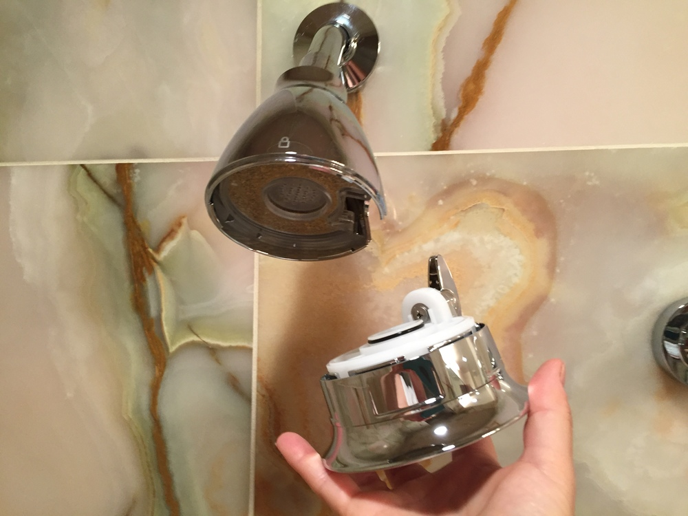 unlock the bottom section on hotel pure shower head to remove and replace the filter