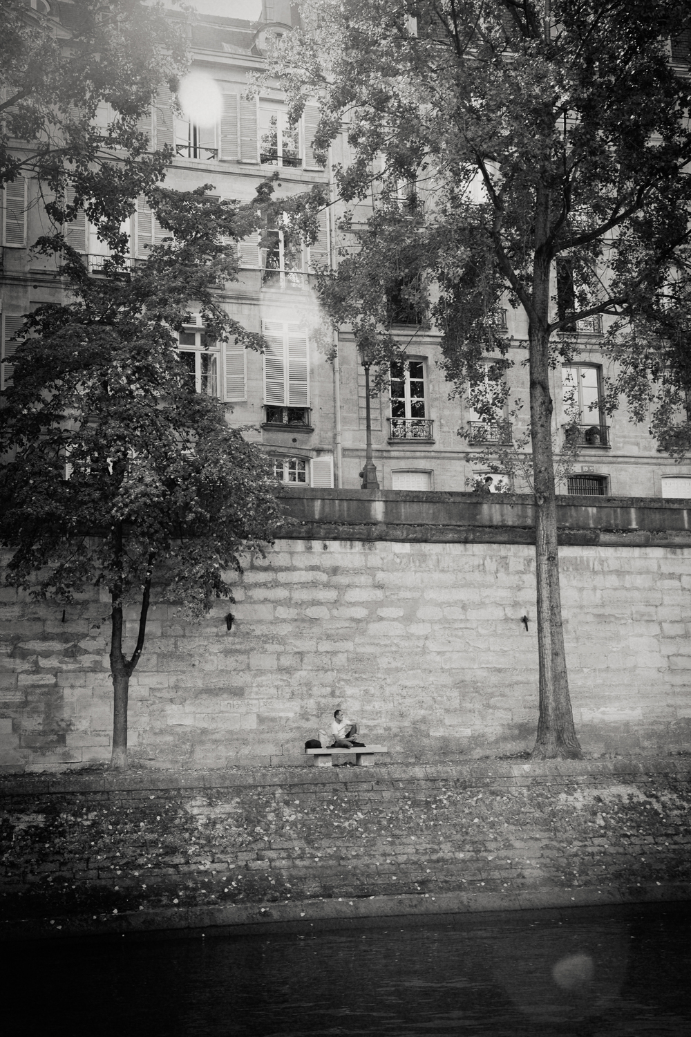 man on bench, River Seine, Paris 2014.