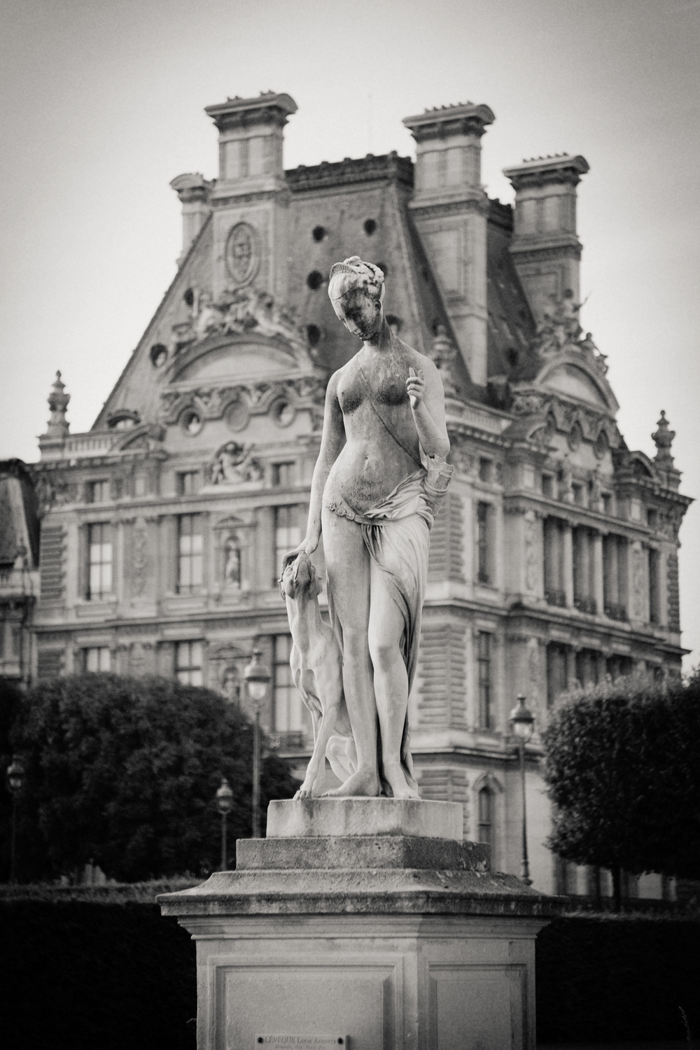 statue outside Louvre, Paris 2014.