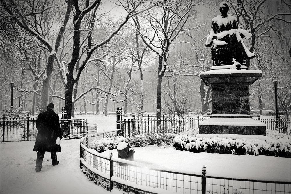 man in snow, Madison Square Park, NY 1999.