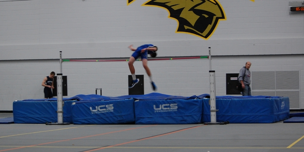 Grant Abraham clears the high jump bar gracefully.