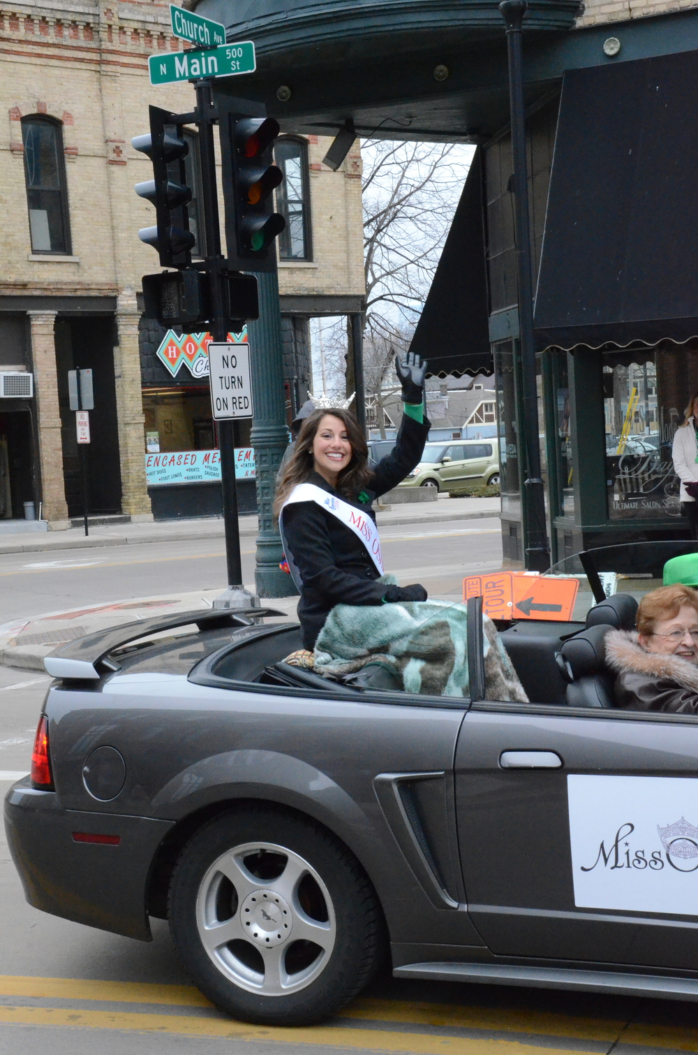 iss Oshkosh Serena Larie greets the crowd in a convertible. Larie won the crown on March 12.