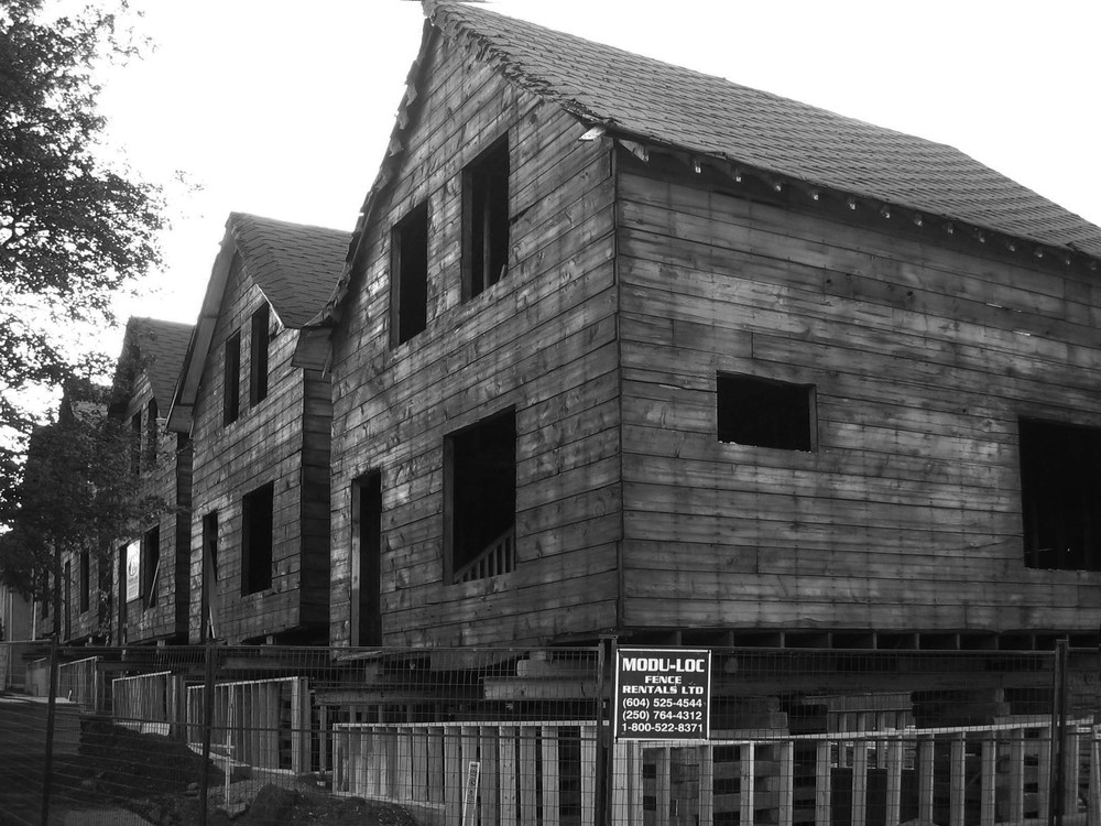 Five houses stripped down to sheathing