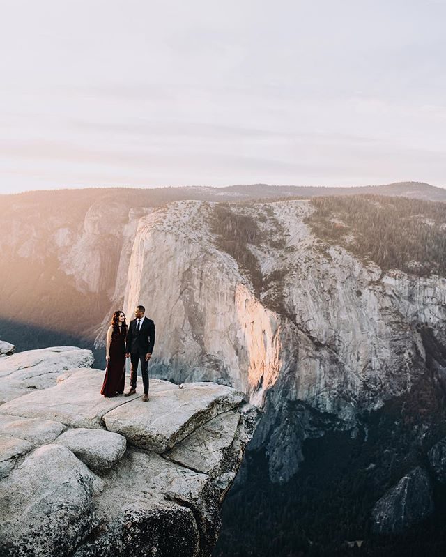 I didn't know I was afraid of heights until this moment⠀ 🙈⠀ BUT LOOK AT THAT LIGHT AND THOSE BABES!!! How do I get the best, most genuine and adventurous clients? Honestly. How? ✨⠀ #adventurewedding #engagementphotography #loveintentionally #bedeeplyrooted #whyweadventure #shootthepeople #alifealive #belovedstories #firstandlasts #catebethphotography #yosemiteengagement #taftpoint #bayareaweddingphotographer #californiaweddingphotographer