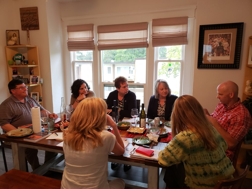 "For the first meeting of the Leadership Book Club, LSC alumni and friends gathered in Kathy Coffey's home to discuss ""Who Do We Choose to Be"" by Meg Wheatley."