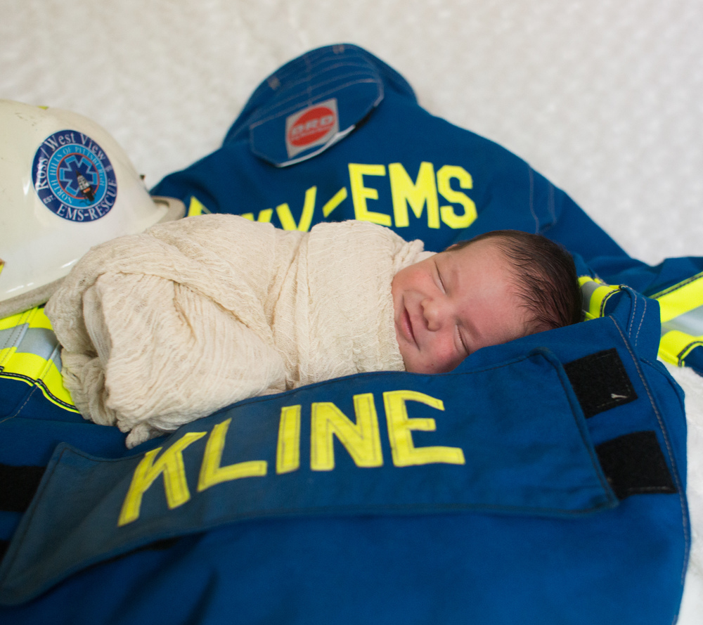 Newborn Smiles and EMT Gear from Daddy