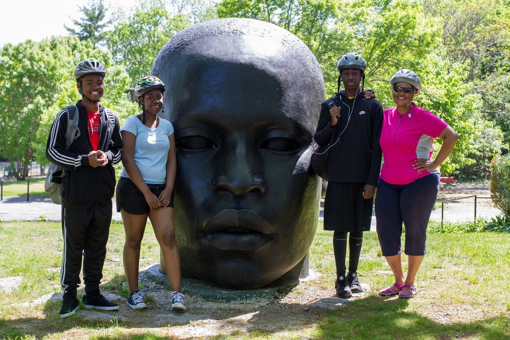 Mattapan Food and Fitness Coalition Vigorous Youth and MFFC members pose with the Big Head Statue!