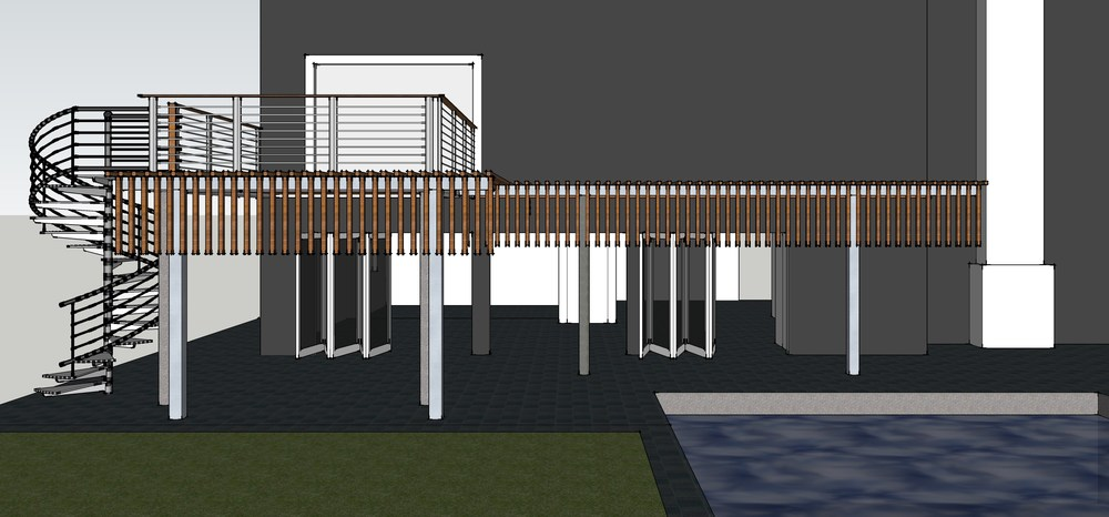 The backyard patio will receive new tile, a trellis above for shade, and a new balcony off the master bedroom.