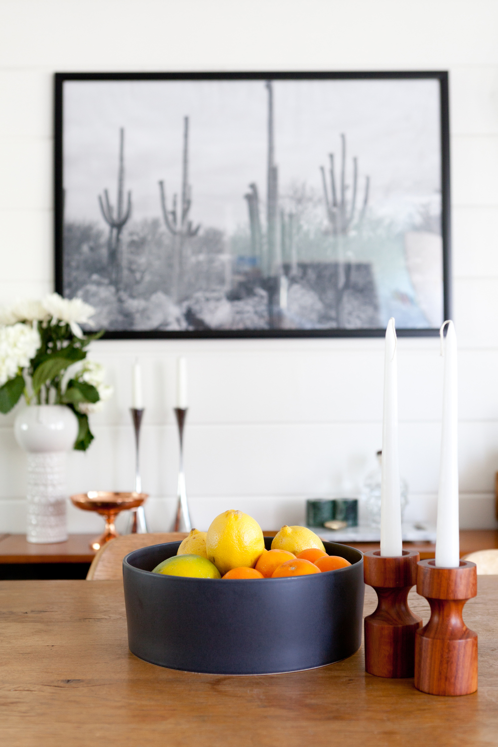 The inexpensive print by  Fine Life Co  truly captures the laid back spirit of my dining area.
