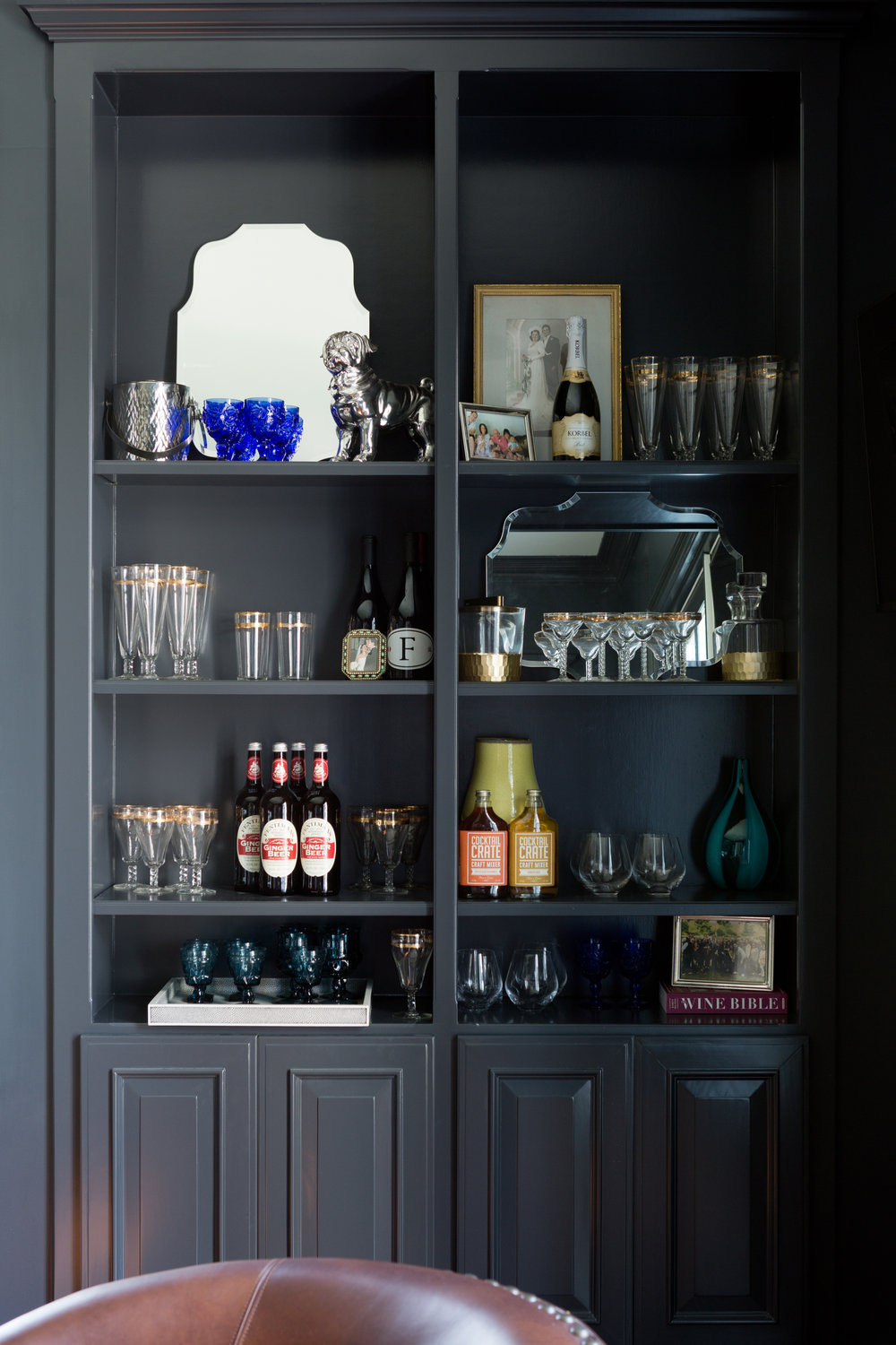 Styling the shelves with barware made a huge difference in making the room feel finished.