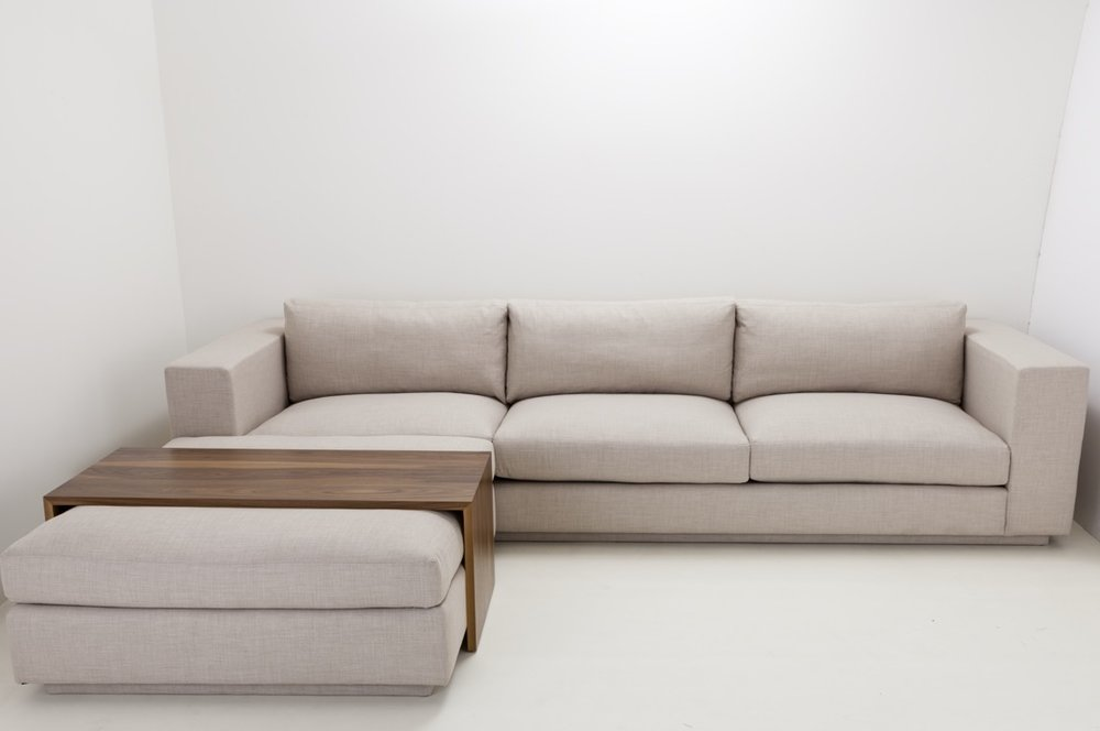 The Playa Vista sectional with walnut wood topper showroom in the factory