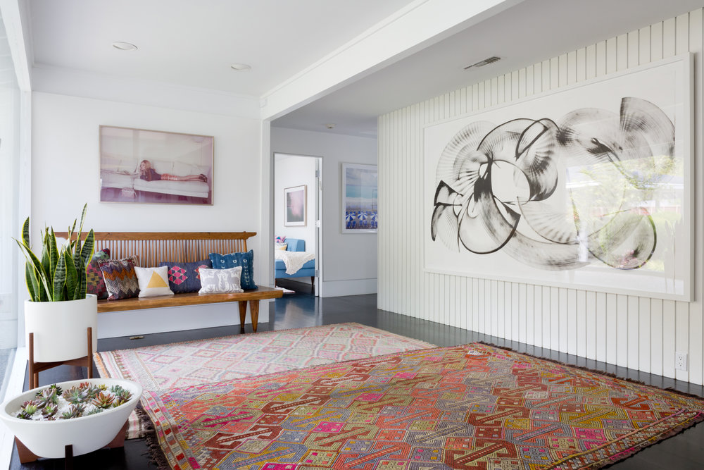 Hollywood Hills entry with layered kilims