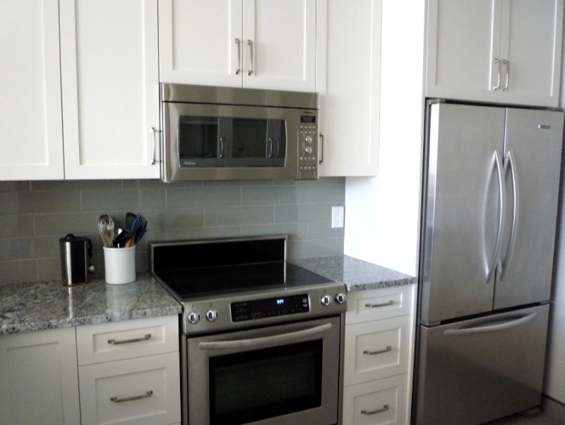 Kitchen Renovation in Vancouver - Granite Countertops, Stainless Steel Applicances, White Cabinets