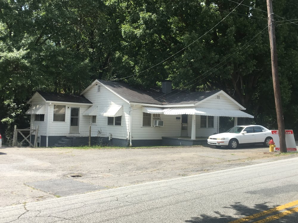 PROPERTY # 108 2 of 2: - Commercial Building and adjacent Garage currently rented for $850/mo2 Bedroom Home currently rented for $450/mo to the same tenant for 28 yrs. There is also a basement apt currently vacant.Large 240'x138' Zoned CC Lot with All UtilitiesProperty Taxes: $1,600