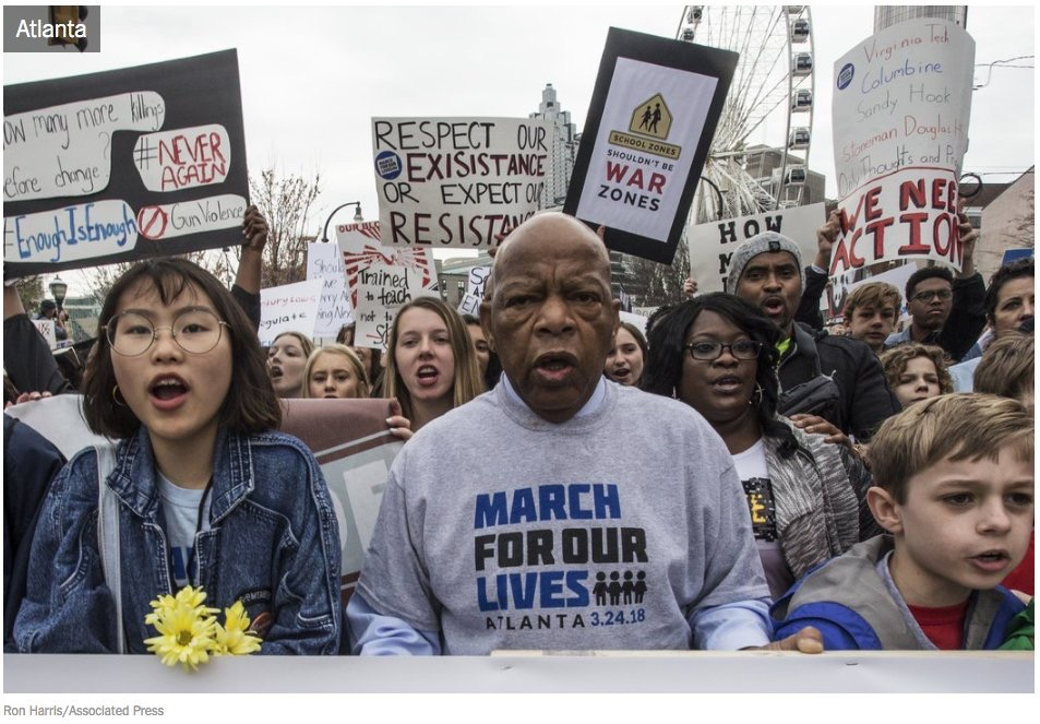 Rep. John Lewis marching with student activists in March For Our Lives in Atlanta.