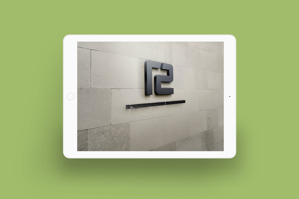 R Squared logo placed on exterior wall