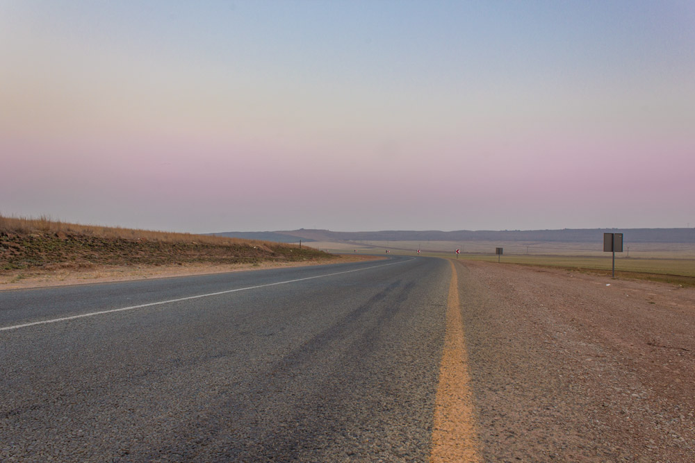 Road towards Magaliesburg and the Magaliesberg Mountains.