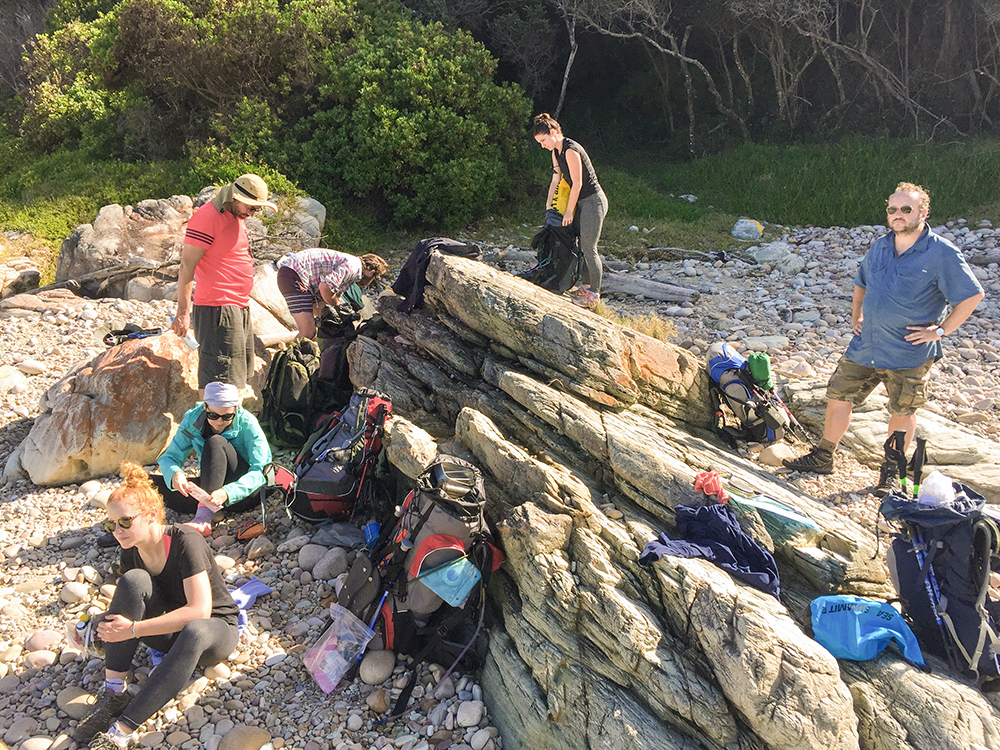 We crossed Bloukrans River very early in the morning, which meant that at 9AM we had most of our day's hiking done. Snoozing on the rocks is a great way to spend a Thursday morning.   Click image to expand.