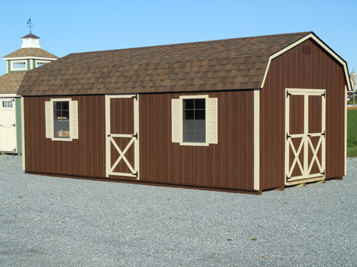 12'x24' Dutch Barn with Brown Duratemp Siding / almond Trim / Dual Brown Shingles. Options Shown: Shutters / Additional 3' Door