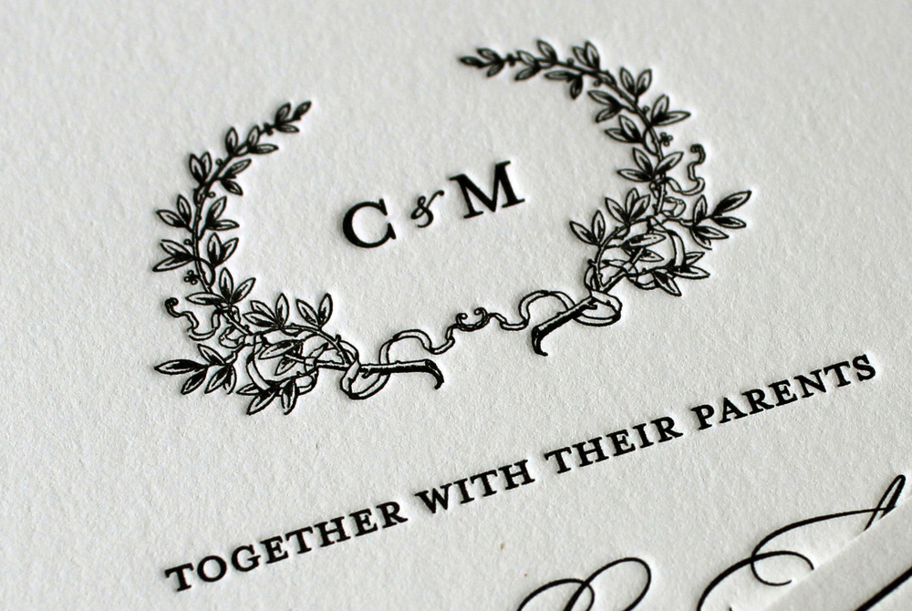 black-white-floral-wreath-monogram-letterpress-wedding-invitations