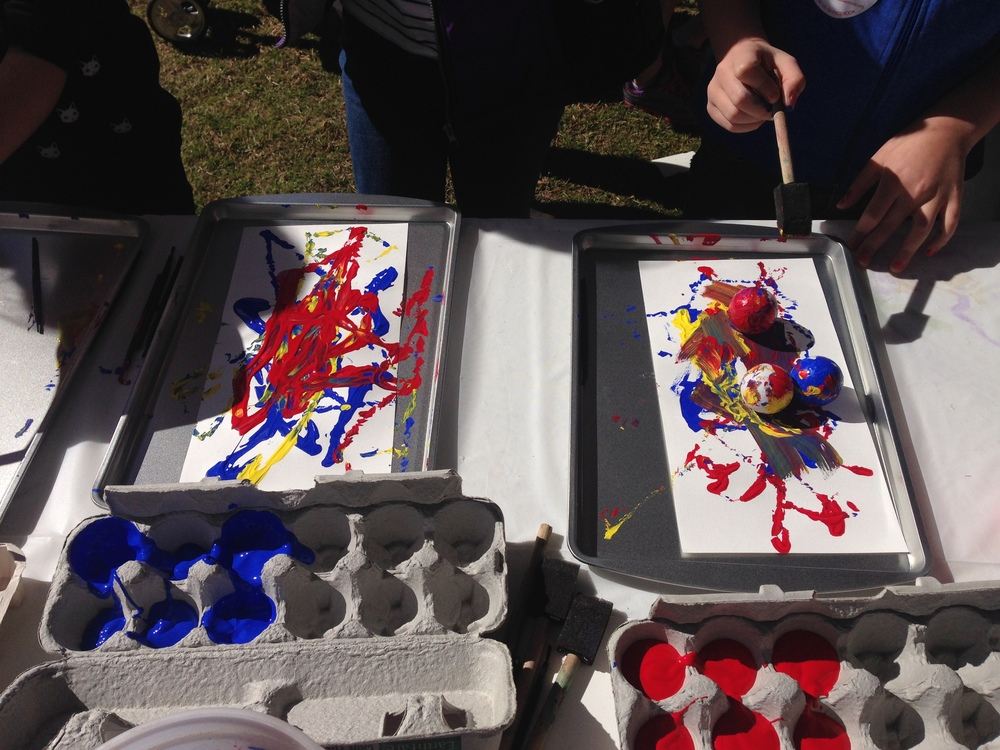 At the Charleston Stem Festival , HwH provided students an opportunity to paint with ping pong balls and golf balls. Forces and Motion in painting with the ping pong balls dipped in the primary colors.
