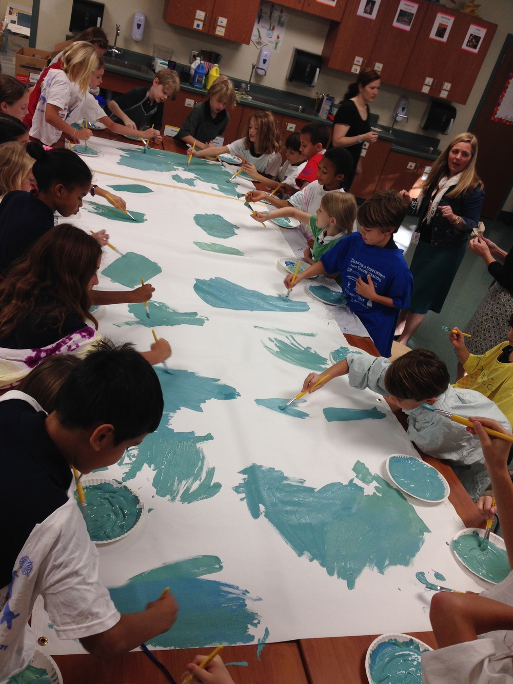 Students begin painting their canvas for their mural to be on display at the Gaillard Performing Arts Center.