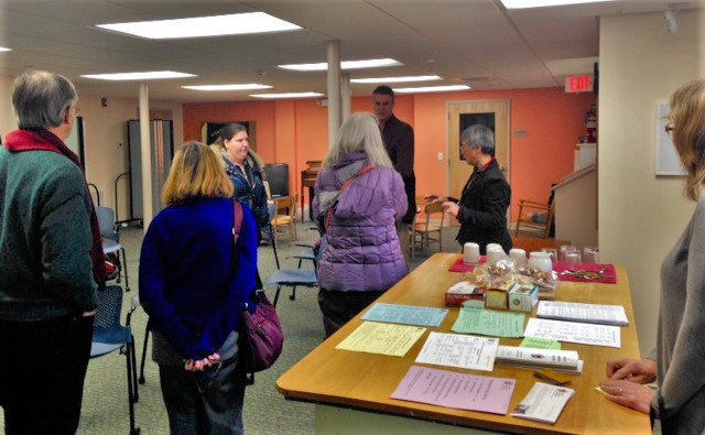 Community members participating in a housing information session that included a guided tour of the One-Stop Resource Center's facilities.