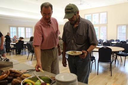 Unitarian Universalist Society member Peter Rogers, right, and Craig's Doors board member Gerald Weiss, left, look over the breakfast offerings at the first community breakfast offered by the society and Craig's Doors in the society's new space. Amherst Community Connections will offer meals here on the days no other agency provides one.   (Republican file)  Photo courtesy of The Republican website. ACC does not own the rights to this image.