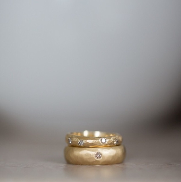 Mika + Ben (wedding bands)  18k yellow gold, chocolate diamonds.  Photo credit: Bonica Ayala