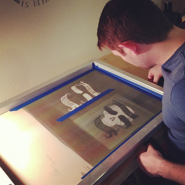 Mitch lining things up, getting ready to lay down some ink for a new print he designed. (at Screenprinters Anonymous)
