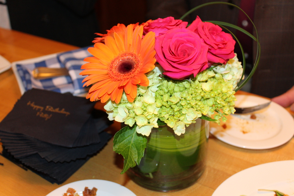 floral arrangement and napkins