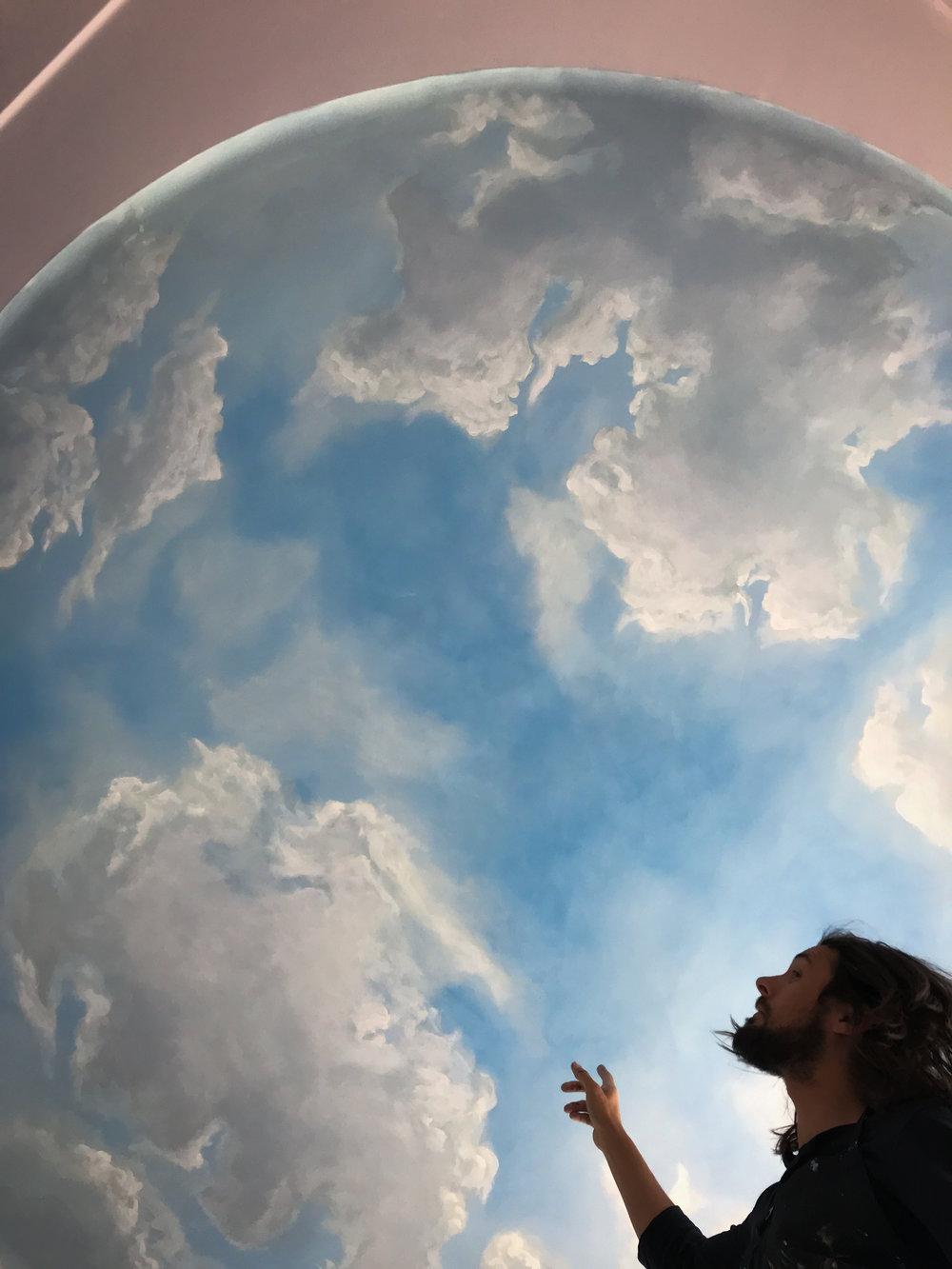 Muralist showing cloud ceiling detail.jpg