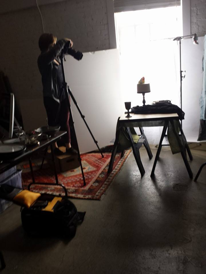 Photographer Elysa Weitela snapping pics at her studio of one of cakes.