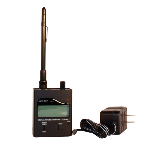 This HAND-HELD RADIO FREQUENCY COUNTER is compact, truly pocket-sized, versatile test instrument designed for measuring any digital, on/off keying or analog signal on frequencies between 30 MHz and 2.8 GHz. Comes complete with internal NiCd pack, AC wall charger and 7 section telescopic antenna.