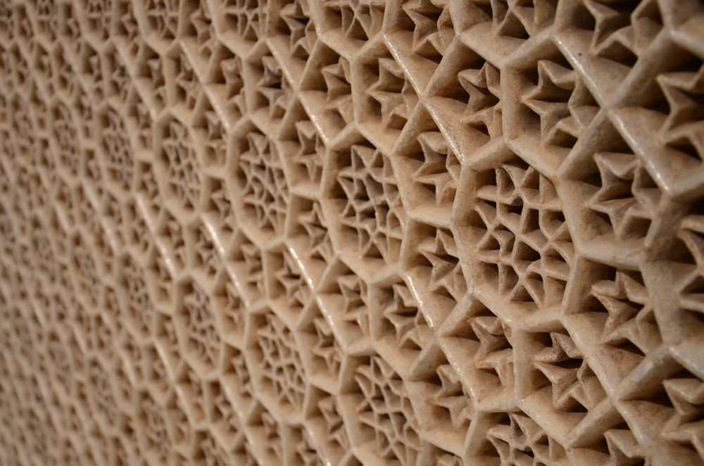 Intricate stone latticework of the tomb