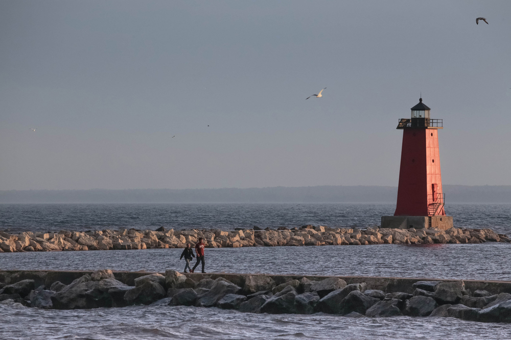The Manistique East Breakwater Lighthouse at the Lake Michigan Beach in Manistique, MI is seen as the sun sets in the state's Upper Peninsula. Ryan Garza / Pop Mod Photo