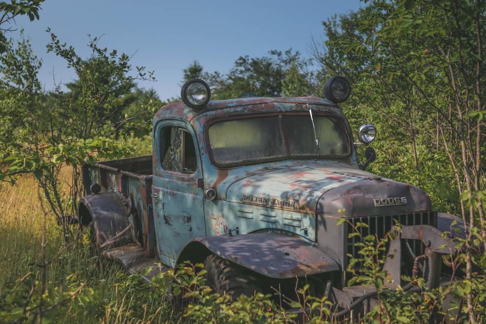 A weathered Dodge truck sits in a field in Calumet, MI in the state's Upper Peninsula. Ryan Garza / Pop Mod Photo