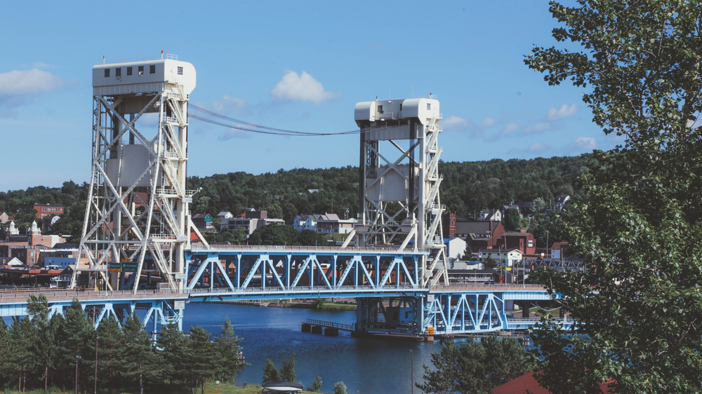 The Portage Lake Lift Bridge is seen in front of downtown Houghton, MI in Michigan's Upper Peninsula that separates the city from Hancock, MI. Ryan Garza / Pop Mod Photo