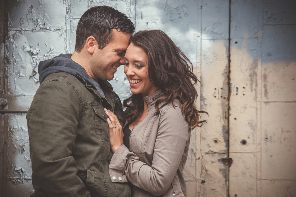 downtown-engagement-flint-michigan-couple-embrace-pop-mod-photo.JPG