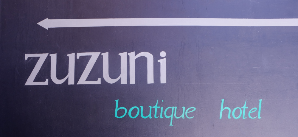 Zuzuni Boutique hotel sign