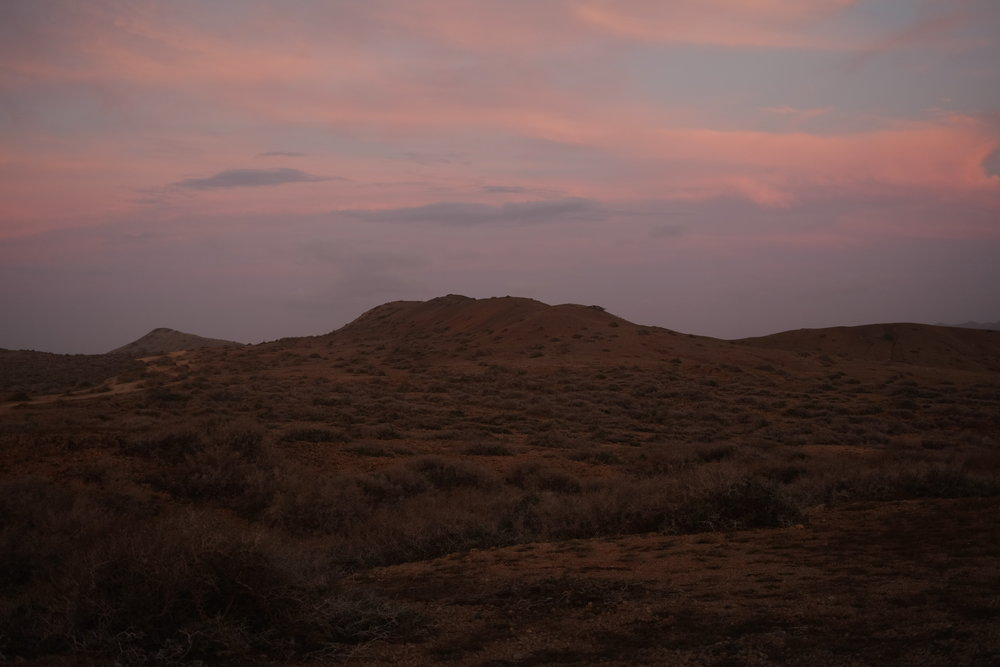 Pink skies and desert plains.
